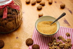 Baking background. With ginger cookies, brown sugar and nuts on wooden table Stock Image