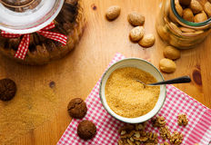Baking background. With ginger cookies, brown sugar and nuts on wooden table, top view Stock Photography