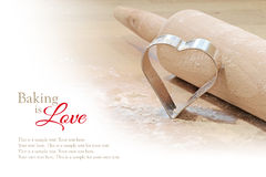 Baking background, heart cookie cutter and rolling pin