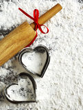 Baking background with heart cookies molds and rolling pin Stock Photos
