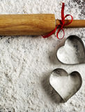 Baking background with heart cookies molds and rolling pin Royalty Free Stock Image
