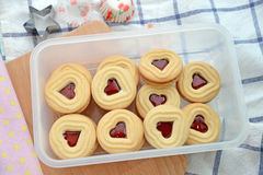 Baking background  heart cookies on wooden board Stock Photos