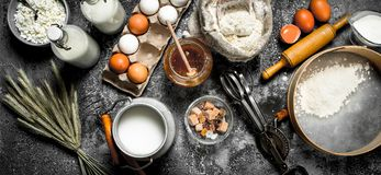 Baking background. Ingredients and tools for dough preparation. Royalty Free Stock Photo