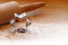 Baking background, rolling pin and cookie cutter in star shape Stock Photo