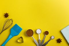 Baking background with spices and kitchen tools royalty free stock image