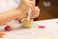 Baking. Cookies and cupcakes in a class Stock Image