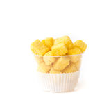 Baking biscuit covered by sugar and cheese in plastic cup Stock Images
