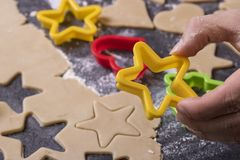 Baking biscuits in advent and christmas at home. Man, hand, fingers, star stock photography