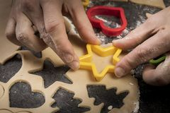 Baking biscuits in advent and christmas at home. Man, hand, fingers, star royalty free stock images