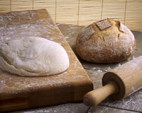 Baking Bread. Bread baking scene with rolling pin and cutting board Royalty Free Stock Photos
