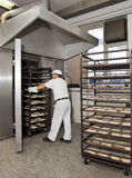 Baking a bread. Raw bakery products ready for next phase - baking at a proper temperature Royalty Free Stock Image