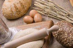 Baking bread. Preparing fresh homemade bread with whole grains Royalty Free Stock Images