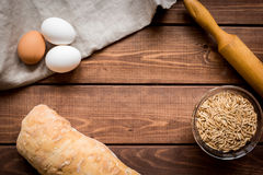 Baking bread ingredients on wooden table background top view mockup Stock Photo