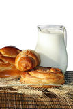 Baking bread and jug with milk Royalty Free Stock Photos