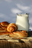 Baking bread and jug with milk Royalty Free Stock Photography