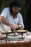 Baking bread. Man with a beard, cut the dough stock photos