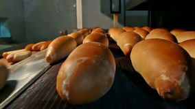 Baking bread in the oven stock footage
