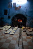 Baking bread pieces in ancient Medina of Fez in Morocco Stock Image