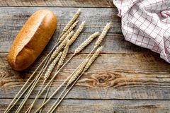 Baking bread with wheat flour and ears on table rystic background top view mockup Stock Images