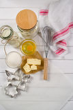 Baking cake . Dough  recipe ingredients eggs, flour, milk, butter, sugar and rolling pin Royalty Free Stock Photo