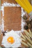 Baking cake. Eggs, flour, wheat on vintage wood table Stock Photo