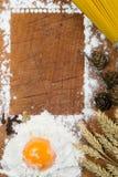 Baking cake. Eggs, flour, wheat on vintage wood table Royalty Free Stock Photo