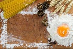 Baking cake. Eggs, flour, wheat on vintage wood table Stock Images