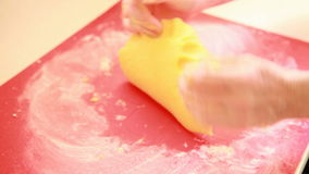 Baking cake. Female hands making dough and showing thumb up Royalty Free Stock Photos