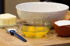Baking a Cake. Ingredients needed to begin baking a delicious cake Royalty Free Stock Photography
