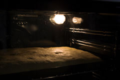 Baking cake in oven. Oven with light Royalty Free Stock Photography
