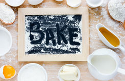 Baking cake or pancake in rustic kitchen - dough recipe ingredie. Nts (eggs, flour, milk, butter, sugar) on white planked wooden table from above Royalty Free Stock Photography