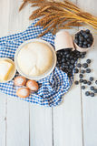 Baking cake in rural kitchen - cake recipe with berries. Royalty Free Stock Photography