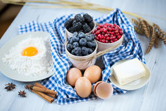 Baking cake in rural kitchen - cake recipe with berries. Stock Photos