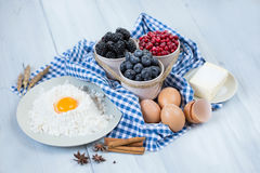 Baking cake in rural kitchen - cake recipe with berries. Royalty Free Stock Photo