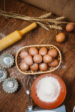 Baking cake in rural kitchen - dough  recipe ingredients eggs, flour, sugar on vintage  wooden table from above. Stock Photography