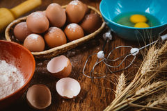 Baking cake in rural kitchen - dough  recipe ingredients eggs, flour, sugar on vintage  wooden table from above. Baking cake in rural kitchen - dough  recipe Royalty Free Stock Photography