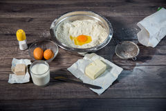 Baking cake in rural kitchen. Baking cake on wooden table in rural kitchen Royalty Free Stock Images