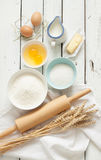 Baking cake in rustic kitchen - dough recipe ingredients on white wooden table Royalty Free Stock Image