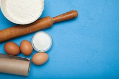 Baking cake in rustic kitchen eggs, flour, milk, butter, sugar. Background layout with free text space royalty free stock image
