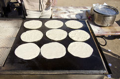 Baking chapati in Delhi market, India Stock Photography