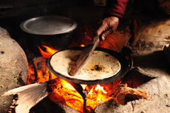 Baking Chapati on Wood Fire. Taken in a Shepherd Hut in karakoram, Pakistan Stock Photos