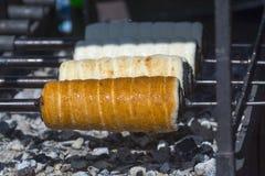 Baking chimney cakes royalty free stock image