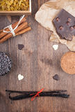 Baking with Chocolate. Ingredients for baking chocolate on a dark wooden background Stock Photos