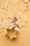 Baking christmas cookies. Baking star shaped christmas cookies Stock Photography