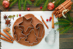 Baking Christmas cookies. Gingerbread dough, cookie cutters and Stock Photos