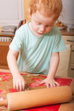 Baking Christmas cookies. Little girl baking cutting pastry for Christmas cookies stock photography