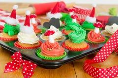 Baking Christmas cupcakes Royalty Free Stock Photos