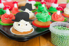 Baking Christmas cupcakes Royalty Free Stock Photography