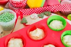 Baking Christmas cupcakes Stock Photos
