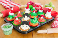 Baking Christmas cupcakes Royalty Free Stock Photography
